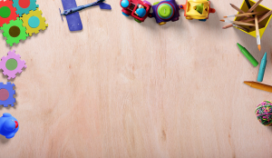 background with children toys on a wooden floor 300x174 - background-with-children-toys-on-a-wooden-floor