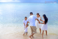 family enjoying vacation on the beach 120x80 - 3 Holiday Travel Tips for Parents