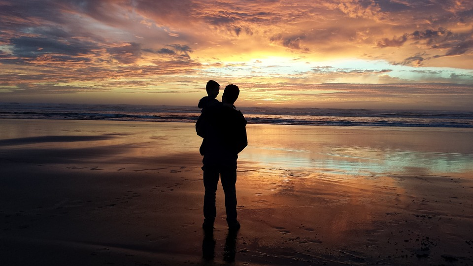 father son grandson man child on a sunset - 3 Holiday Travel Tips for Parents