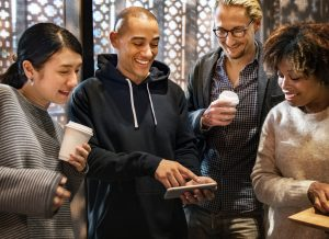 group of men and women smiling while looking at phone 300x218 - group-of-men-and-women-smiling-while-looking-at-phone